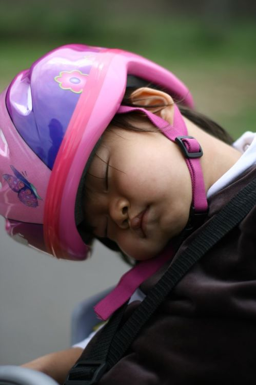 baby sleeping on a bike