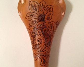 floral branded saddle