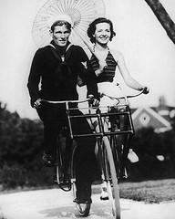sailor couple on bike