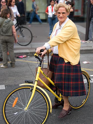 Mrs. Doubtfire look alike on a bike