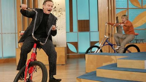 Robin bikes with Ellen